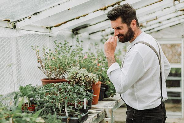Michael Perry, aka Mr Plant Geek, smelling herbs